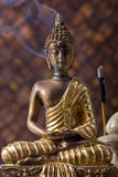 Buddha With Incense Stick. Buddha idol with incense sticks against bamboo background stock images