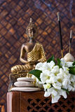 Buddha With Incense Sticks And Flowers Royalty Free Stock Image