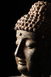 Buddha-Kopf getrennt auf schwarzem Hintergrund Lizenzfreie Stockbilder