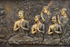Buddha life scenes on carved metal Stock Photo