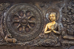 Buddha life scenes on carved metal Royalty Free Stock Image