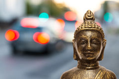 Buddha with lights of road traffic Stock Images
