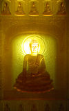 Buddha with long lighting candle royalty free stock photography