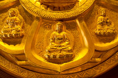 Buddha on lotus carved wood with gold paint over royalty free stock photos