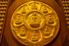 Buddha on lotus carved wood with gold paint over stock images