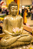 Buddha with Lotus Flower  at the Festival of the Orient in Rome Italy. The Festival of the Orient was held at the Exhibition Centre near Rome Airport at Royalty Free Stock Photography
