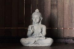 Buddha in lotus position Royalty Free Stock Photo