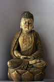 Buddha in lotus position Royalty Free Stock Image