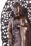 Buddha with a lotus and a swastika. Royalty Free Stock Photos