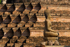 Buddha and lovely brick pattern Stock Photos