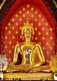 Buddha made of gold metal. Royalty Free Stock Image