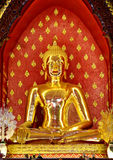 Buddha made ​​of gold metal. Royalty Free Stock Image