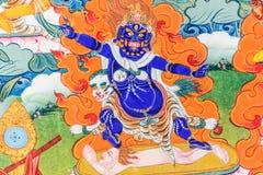 Buddha Mahakala Tibetan thangka painting closeup, medicine Buddha. Buddha Mahakala the protector coloured Tibetan thangka painting, medicine Buddha stock image
