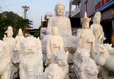 Buddha marble sculptures on the fabric royalty free stock photography