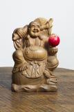 Buddha med det röda äpplet fotografering för bildbyråer