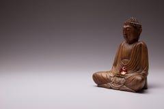 Buddha med en Glass hjärta arkivfoto