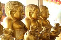 Buddha med pengar Arkivbilder