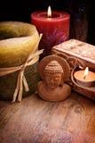 Buddha med stearinljus Arkivfoton