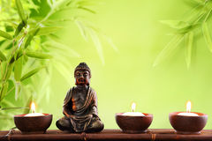 Buddha in meditation. With burning candle Royalty Free Stock Images