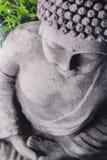 Buddha in meditation. Buddha in forest of bamboo praying Stock Photo