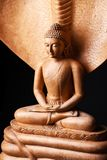 Buddha in a meditation pose, under protection of the Muchalinda. Buddha in a meditation pose, under protection of the king of nag - Mukalinda. Figure isolated on stock images