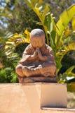 Buddha Meditation. Sitting Buddha Meditation against Green Plants Background Royalty Free Stock Image