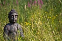 Buddha Meditation. Buddha statue meditating on a meadow stock photos