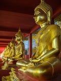 Buddha-Messingstatuen-Sitzen Stockfotos