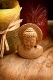 Buddha mit Kerzen Lizenzfreie Stockfotos