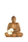 Buddha mit Orchidee-Blume Stockfotos