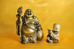 Buddha and the monk. Happy Buddha monks with the Piper Royalty Free Stock Photography