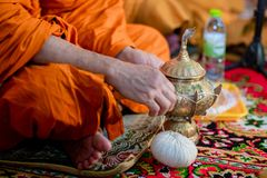 Buddha monk hold candlestick above holy water bowl. religion ceremony. Buddhist holy water. image for copy space royalty free stock image