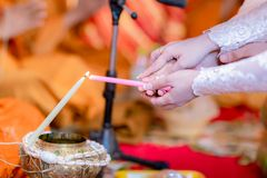 Buddha monk hold candlestick above holy water bowl. religion ceremony. Buddhist holy water. image for copy space royalty free stock images