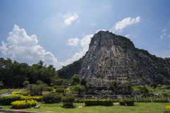 Buddha Mountain Khao Chee Chan. 130 mtr high Buddha laser carved and inlayed with gold on Khao Chee Chan Cliff, Sattahip, Chonburi province, Thailand royalty free stock images