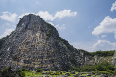 Buddha Mountain Khao Chee Chan. 130 mtr high Buddha laser carved and inlayed with gold on Khao Chee Chan Cliff, Sattahip, Chonburi province, Thailand stock image