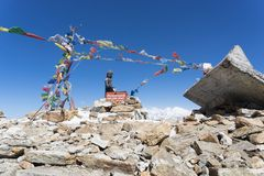 Buddha on mountain summit Nepal. Praying flags and buddha in Nepal trek summit Stock Image