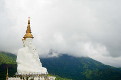 Buddha mountains and fog. Buddha on the mountain surrounded by mountains and fog Royalty Free Stock Photography