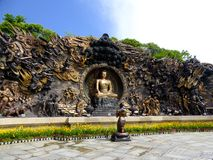 Buddha Murals statue at Lingshan. A bronze Buddha with his disciple kneeling in the front to pary Murals statue at Lingshan in wuxi city jiangsu province China Royalty Free Stock Photos