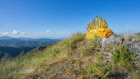 Buddha and naga on mountain range Royalty Free Stock Image