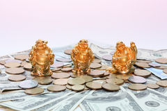 Buddha netsuke and money. Budai (Hotei) is a Chinese folkloric deity Stock Photo