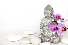 Buddha and orchid Royalty Free Stock Photo