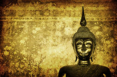 Buddha over grunge wall Royalty Free Stock Photography