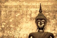 Buddha over grunge wall Stock Photos
