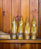 Buddha på modelldetaljen av teakträguld Royaltyfri Bild