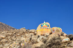 Buddha Painting on the mountain, Drepung Monastery Royalty Free Stock Images