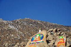 Buddha Painting on the mountain, Drepung Monastery Stock Photo