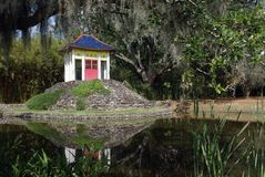 Buddha Pavilion. At the Jungle Gardens of Avery Island, Louisiana.  The pavilion houses a 1000 year old statue of Buddha Stock Photo