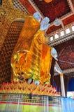 Buddha permanente Imagen de archivo libre de regalías