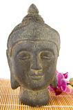 Buddha with pink orchid Stock Images