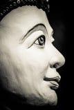 Buddha portrait isolated on black Stock Photography